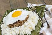 pic of loco  - Loco Moco a traditional Hawaiian dish of teriyaka flavored ground beef patty and a fried egg on a bed of rice smothered in gravy - JPG