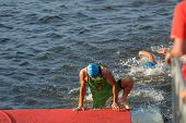 DNEPROPETROVSK, UKRAINE - MAY 24, 2014: Danylo Sapunov, Ukraine leading after the swimming stage of