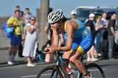 DNEPROPETROVSK, UKRAINE - MAY 24, 2014: Oleksandra Stepanenko, Ukraine races on the cycling stage of ETU Sprint Triathlon European cup. It's the first time Triathlon European Cup take place in Ukraine