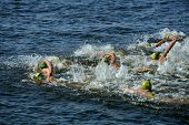 DNEPROPETROVSK, UKRAINE - MAY 24, 2014: Female athletes swim on the fist stage of ETU Sprint Triathl