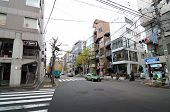Tokyo - November 28, 2013: Traffic At The Intersection Of Daikanyama District