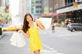 Urban shopping woman in New York City street with yellow taxi cab. Beautiful happy summer shopper ho