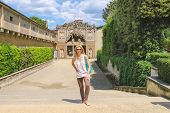 image of grotto  - Attractive girl near the grotto Buontalenti in the Boboli gardens - JPG