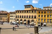 Tourists On A Sloping Square Before The Palace Pitti. Florence, Italy