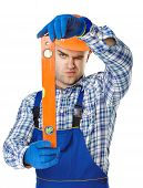 Young Construction Worker With Spirit Level