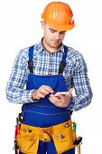Young Construction Worker With Smartphone