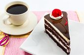 Chocolate Cake Slice With Red Cherry Fruit And Coffee.