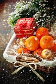 Mandarins In Basket And Christmas Tree Branch