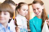 stock photo of pre-adolescent child  - children draw with the teacher in the classroom drawing  - JPG