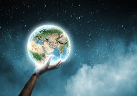 pic of save earth  - Close up of human hand holding Earth planet - JPG