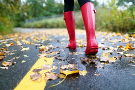 picture of wet feet  - Autumn fall concept with colorful leaves and rain boots outside - JPG