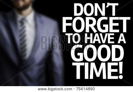 Don\'t Forget to Have a Good Time written on a board with a business man on background