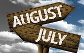 Time concept on wooden sign, August x July