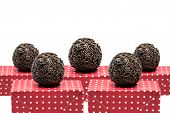 Traditional Brazilian Brigadeiro on white background