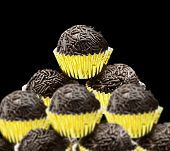 Lots of Brazilian Brigadeiro on black background