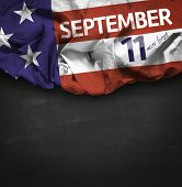 9/11 Patriot Day, September 11 waving flag on blackboard background