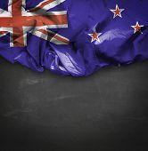 New Zealand waving flag on blackboard