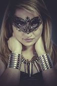 Performer, Beautiful blonde with silver jewelry and mask