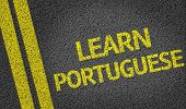 Learn Portuguese written on the road