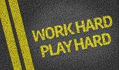 Work Hard Play Hard written on the road