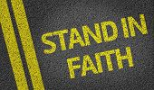 Stand in Faith written on the road