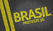 Brasil, Proteste nas Urnas written on the road (in portuguese: translate: Brazil, Protest Now!)