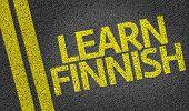 Learn Finnish written on the road