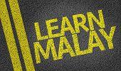 Learn Malay written on the road