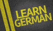 Learn German written on the road