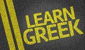 Learn Greek written on the road