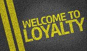 Welcome to Loyalty written on the road