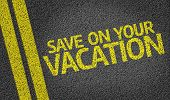 Save on Your Vacation written on the road