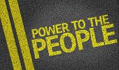 Power to the People written on the road