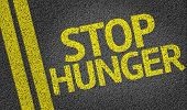 Stop Hunger written on the road
