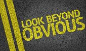 Look Beyond Obvious written on the road