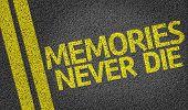 Memories Never Die written on the road