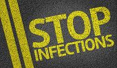 Stop Infections written on the road