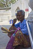 Old Asiatic Woman Smoking An Handmade Cigar