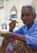 Old Asiatic Woman Smoking