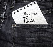 This is Your Time written on a peace of paper on a jeans background