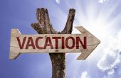 Vacation wooden sign on a beautiful day