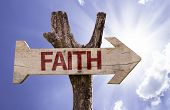 Faith wooden sign on a beautiful day
