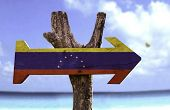 Venezuela wooden sign with a beach on background