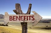 Benefits wooden sign on desert background