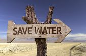 Save Water wooden sign isolated on arid background