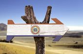 Paraguay wooden sign with a desert background