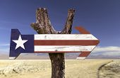 Liberia wooden sign with a desert background