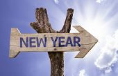 New Year wooden sign on a beautiful day