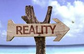 Reality wooden sign with a beach on background