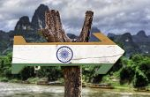 India wooden sign with a forest background